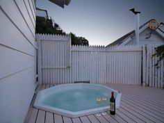 Toast the sunset in your private jacuzzi at 62 on Fourth, Clifton. Jacuzzi, Toast, Romantic, Sunset, Outdoor Decor, Home Decor, Products, Decoration Home, Room Decor
