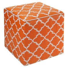 Offer extra seating in the living room or rest a tray of hors d'oeuvres at your next soiree with this eye-catching pouf, showcasing a striking trellis motif....