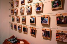 clipboards hung off horizontal wires - lets you change photos regulary credit: Alttext via Curbly [http://www.curbly.com/users/alttext/posts/74-Easy-Photo-Wall-on-a-Shoe-s-string-s-wire-Budget]