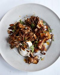 In Mexico, cooks serve this quick casserole of fried tortillas and salsa as a brunch dish with eggs. Alex Stupak omits the eggs and instead combines hen-of-the-woods mushrooms with a spicy, rich salsa made from pasilla chiles, resulting in a light but satisfying vegetarian main course.   Plus: More Brunch Recipes
