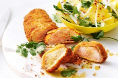 Pork fillet is crumbed in coconut, twice-cooked and served with a tropical side salad of pineapple, radish and lime.