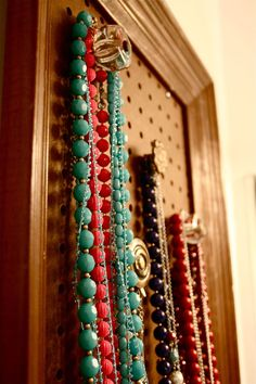 DIY Necklace organizer using drawer pulls, peg board and an old frame - I have just the right frame, too!