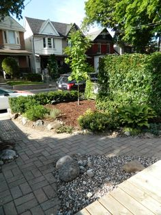 Leslieville front yard garden cleanup after by Paul Jung Gardening Services Toronto.   This typical small city front garden was completely infested with quack grass, which I dug out by hand.The end result? In the words of the client, the front yard isn't the embarrassment of the neighbourhood!
