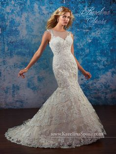 Gorgeous Karolina Sposa dress with beading and illusion neckline. To see more of our beautiful dresses, follow us! @mycouturebridal