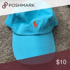 Turquoise Ralph Lauren baseball hat Turquoise Ralph Lauren baseball hat with orange symbol. Barely worn! Polo by Ralph Lauren Accessories Hats