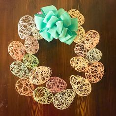 Easter Wreath with DIY Easter Eggs. Easy to make! Starch, a little a Flour, Water. DIY Bow. #Easter #EasterWreath #EasterEggs #DIY #DIYEaster #egg #HomeDecor #NewHome #Love #DollarTreeRibbon #HotGlue #AfternoonProject #ClassroomCraft #Colorful #Home #Photography
