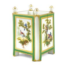 A SÈVRES ORANGE TUB THE PORCELAIN 1769, THE DECORATIONOF LATER DATE caisse carré with champfered corners,decorated probably at a later date, withexotic bird vignettes within gilded green ground borders