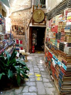 Book Store, Venice, Italy photo via maria.  Do you ever wonder what this might smell like?  Old books, old stone, salt water?  Probably like a book lovers dream.