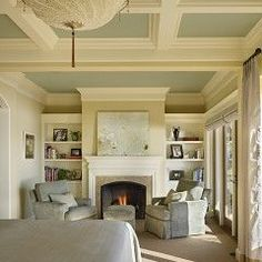 Love the bookshelves.  Love the ceiling and use of color.  Feels fresh and light.