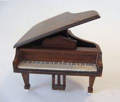 Vintage Shackman Wood Grand Piano Doll House Miniature Furniture. $16.00, via Etsy.