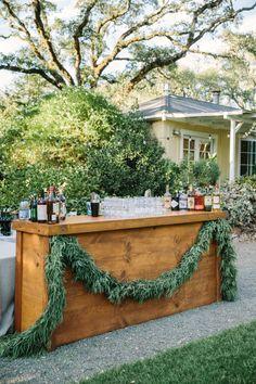Garland draped outdoor bar: http://www.stylemepretty.com/california-weddings/glen-ellen/2016/01/07/glamorous-ranch-wedding-2/ | Photography: The Edges - http://theedgeswed.com/