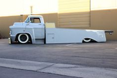 """This is ODIN a Max Grundy Design 1955 Chevy LCF light duty hauler.  Cab also has a 3"""" Gentlemen's Chop with custom glass by Eddie Coto, Front fenders/steps were extended 5"""" to ensure proper stance. Front stock bumper was extended 6"""" for a more industrial look. Leather seat with suede head liner compliment the Cabin. Kustom Bedwood and E-lock fastening system with a fully hand-made kustom bed for hauling hotrods, vintage race cars, motorcycles. Late model HD chassis with all disc HD brakes"""