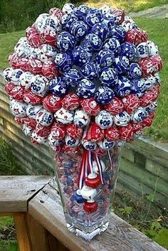Red, White and Blue Tootsie Pop Bouquet - push pops into styrofoam ball fill vase with candy