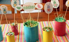 painted old cans and Easter tags on a stick - Cute!