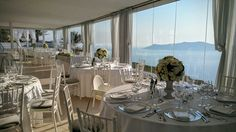 Reception area. Santorini Weddings, Wedding venue, Wedding ceremony and reception, Sunset view.