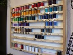 This DIY thread spool holder make me happy for a couple reasons. One, is that it holds 128 spools AND the matching bobbins! Brilliant. Check out more pictures at The Creative Homemaker.
