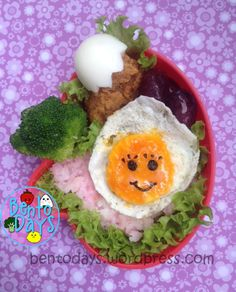 """Putting a face on the yolk!! Nice. """"15 minute bento - fried egg for lunch."""""""