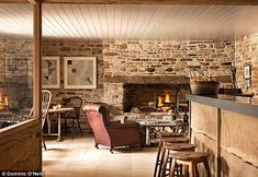 Not one but three log fires crackle away as customers sip down blackberry Bellinis and beers during Jan Moir's visit