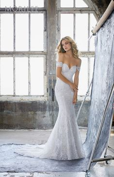 Karissa Wedding Dress. Glamorous Sheath Featuring Deco Inspired Frosted Embroidery on Net. Off-the-Shoulder Cap Sleeves Complete the Look. If I had the figure for this, this would be the perfect dress!