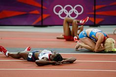Hit the ground running... Britain's Christine Ohuruogu, left, Russia's Antonina Krivoshapka, right, and United States' Francena McCorory lie on the track after competing in the women's 400-meter final. Ohuruogu won silver.