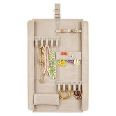 Take your whole collection wherever you go with our Stackers Jewelry Wrap! It has five detachable organizers, two snap closures, a ring roll, earring organizer and a zippered pouch! There are two exterior flaps that still keep your jewelry enclosed and secure even when rolled tightly. Its snap-closure keeps everything wrapped and adds a beautiful accent to this plush product.
