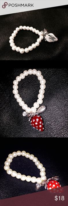 👑💋Handmade baby pearl guess bracelet🍓 This was hand made by me I added real guess charms from a neckless that broke. Beautiful pearl bracelet with Elastic band. Bundle with tiny guess purse and wallet your daughter will be super stylish! It has a darling strawberry charm with diamonds and guess imprint on the back. I have added and extra little diamond charm and guess signature attachment as well🍓🍓🎀👌⚡️💝 GUESS Jewelry Bracelets