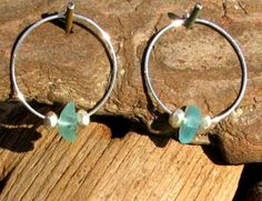 Pretty Light Blue sea glass sterling silver hoop earrings flanked by two Thai Hill tribe sterling silver rondelle beads.