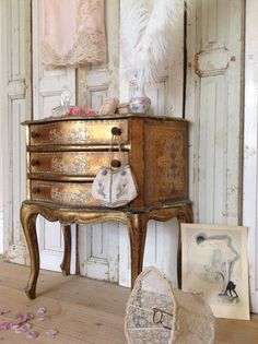 Florentine chest of drawers and antique shutters