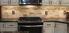 Tumbled #Travertine #tile backsplash with accent strip. | VillageHomeStores.com