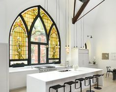 Majestic Church is Transformed into a Gorgeous Modern Home by Linc Thelen Design and Scrafano Architects