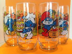 SET OF 4 1983 VINTAGE SMURF GLASSES PEYO PAPA CLUMSY BAKER HARMONY PARTY