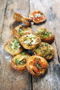 Small pizzas with veggies and herbs and spices…
