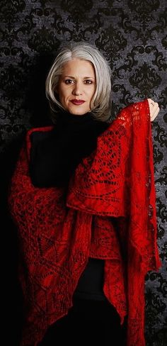 Oh, this is so my look. Love the red lipstick, the red scarf, the black outfit, oh, and...the gray hair.