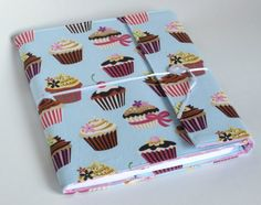Covered composition book. that folds closed and has a pen / pencil holder.  LOVE the cupcake fabric!