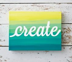 Mask off a word on canvas and paint an ombre design over it.