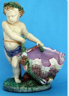 Majolica International Society image from the Karmason Library Master File. Minton Putto and Shell Flower Holder. A.E. Carrier Belleuse