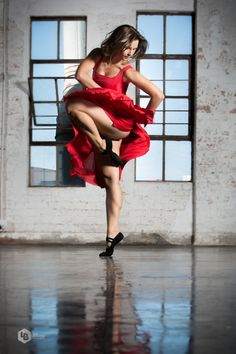Dancers in wear house. I love the contrast of the picture-the red dress and blue sky.