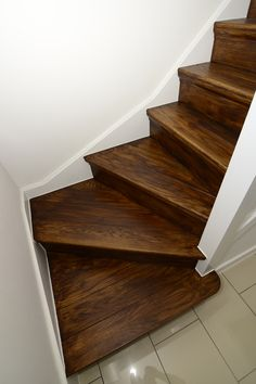 Oak Stair Cladding pre finished by Heritage Doors & Floors LTD with a dark oak oil.
