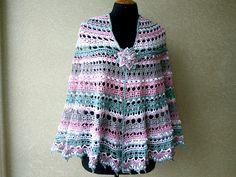 Crochet shawl. Openwork knitted shawl. Striped large crochet.
