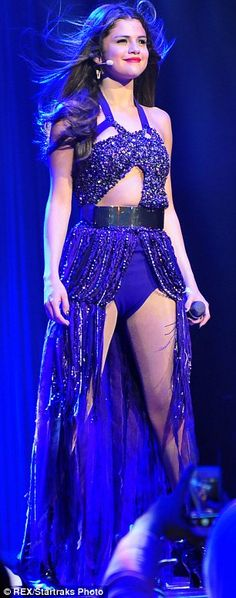 The big reveal: For two of her looks, Selena ripped off her skirt to show off her slim pins in a short number : Click to see more of her pretty concert dresses