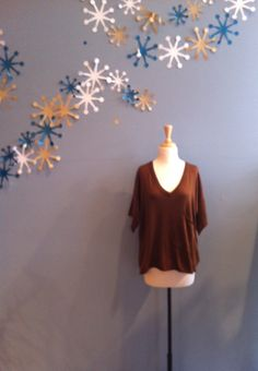 S/S Rust Sweater with Front Pocket by Ya $58.00
