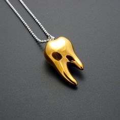 @Rhonda MacLean Wisdom Tooth Pendant Gold silver, gold, jewelry i am soooo gettin you one of these or makin you one wit my platinum clay since you never got your wisdom...and your molars ....I could make a whole back set of teeth for you since ...u know..lol