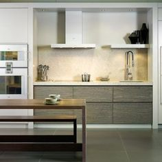 Rustic oak handless kitchen designed by Candi Kitchens