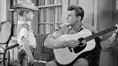 """This 1956 Martin D-18 appeared in several of Andy Griffith's movies, stage, and television performances, beginning with his film debut in Elia Kazan's """"A Face In The Crowd."""" In that role, Andy played """"Lonesome Rhodes,"""" a guitar-playing Arkansas con man. The prop dept painted the new D-18 black and glued sequins on its face. Andy rescued the guitar, removed the sequins and sanded off the black paint. He then had John D'Angelico refinish the D-18 to its original beauty but without a pickguard."""