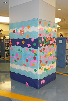 have one pillar with outdoors theme, garden, sea, camping, sports, etc. Have students post books they've read written on leaf, flower, fish, s'more/tent, baseball, etc.