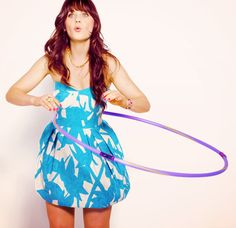 Zooey Deschanel Hula-hooping in a cute dress. Seems like all the celebrities are taking to this new trend.