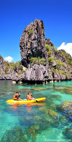 Kayaking inside the mesmerizing Big Lagoon in El Nido | A Travel Guide to Philippines Last Frontier | El Nido and Coron are dream destinations for scuba diving,island hopping, kayaking, snorkeling, hiking, and so much more.Not sure where to go in Palawa