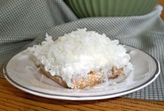 Coconut and Cream Dessert Recipe from RecipeTips.com! Been looking for this for a long time. , /J