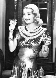 "Constance Bennett in ""Topper Takes A Trip"" (1938) wearing Joseff of Hollywood jewelry."