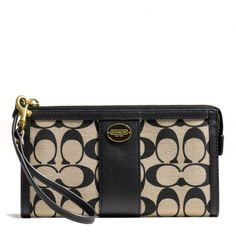 The Zippy Wallet In Printed Signature Fabric from Coach...my newest addition!